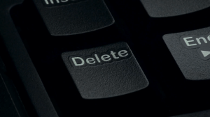 pressing the delete key on a computer keyboard close up noplwf 9x  F0000