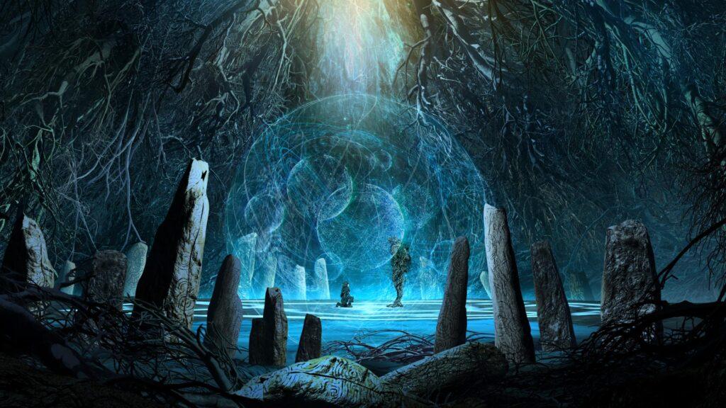 Duas pessos, uma ajoelhada e outra em pé, estão no centro de uma caverna enorme. As paredes estão cheias de raízes de árvores.