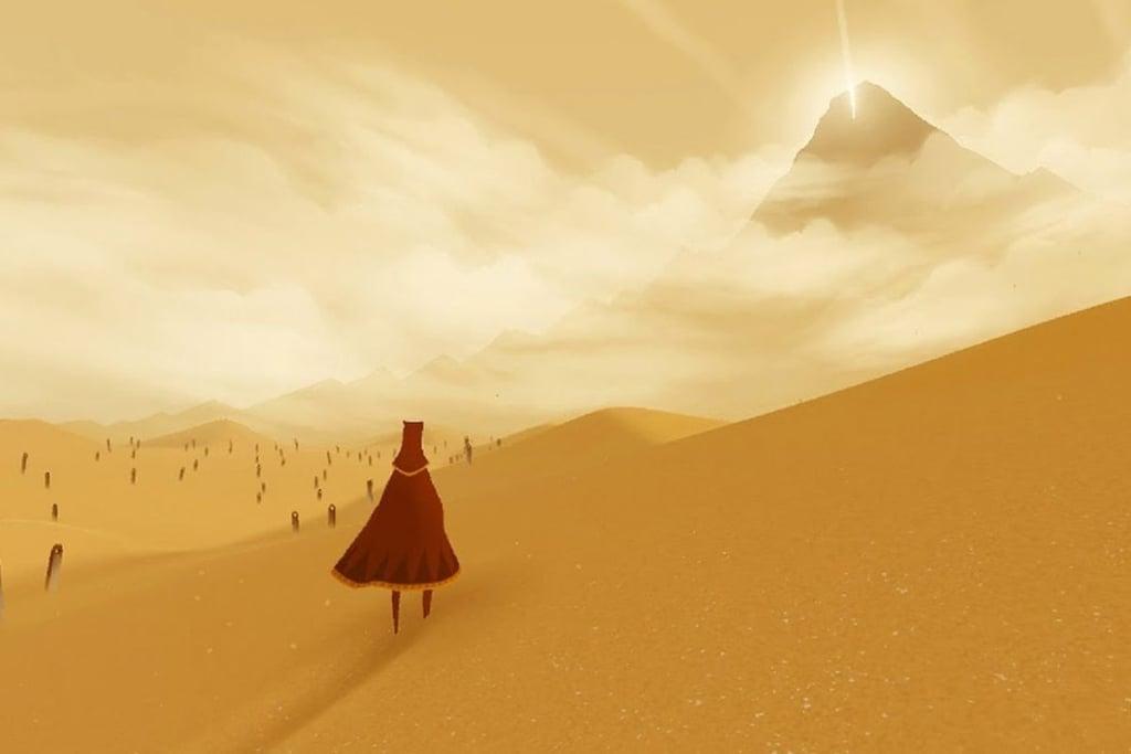 Tela de Journey em que o personagem está de costas olhando para um deserto