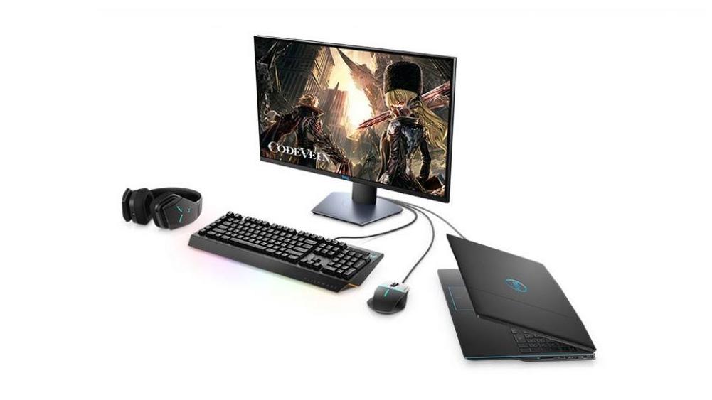 code vein em um monitor, conectado ao notebook da Dell, junto a mouse, headphones e um teclado