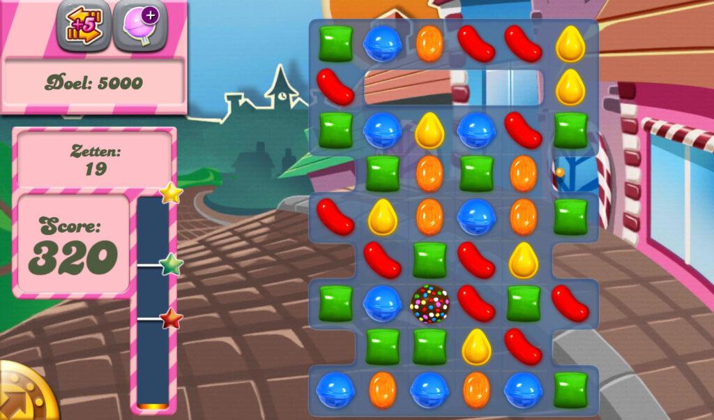 Candy Crush Saga em uma tela dentro do jogo, com diversos doces e pontuação de 320