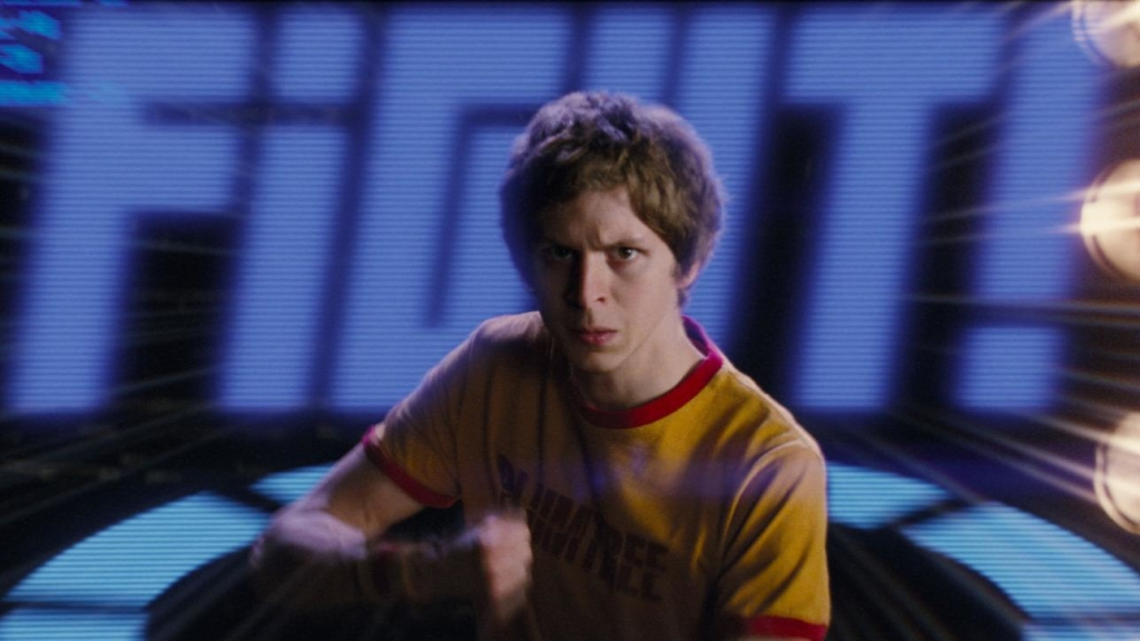 Michael Cera interpretando Scott Pilgrim com texto fight ao fundo