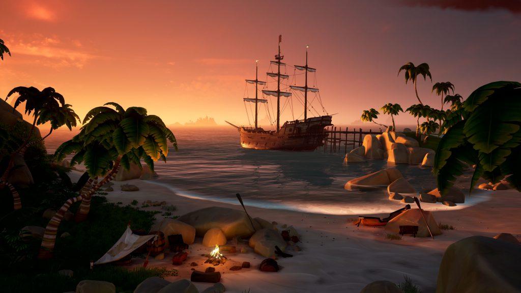 Imagem de praia com um navio pirata ao fundo.