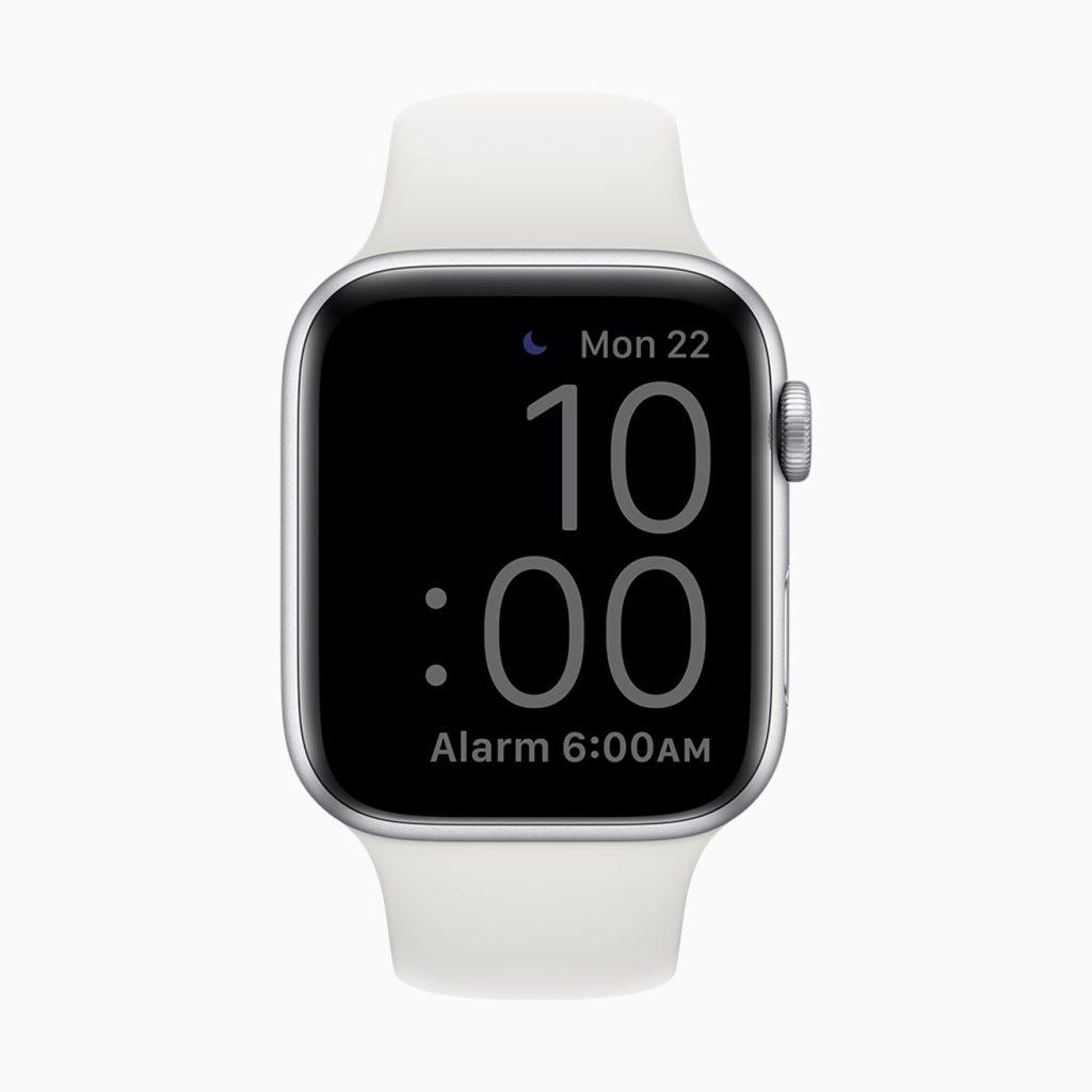 Apple watch no modo dormir. O mostrador exibe o ícone de não perturbe, a data (seg 22), horário atual (10:00) em números grandes e o horário do alarme (6 da manhã).