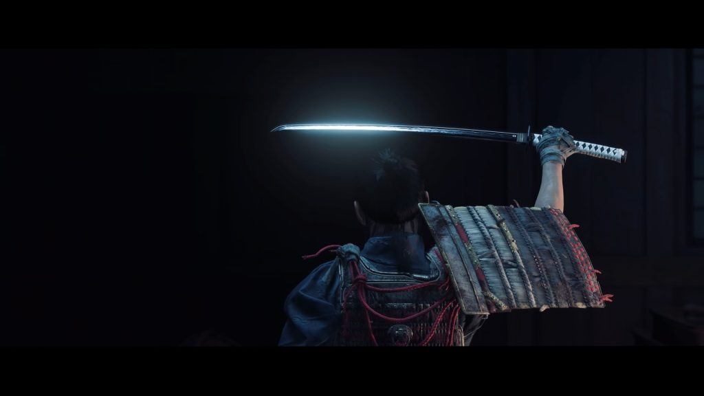 Close do protagonista de ghost of tsushima, jin, segurando sua espada.