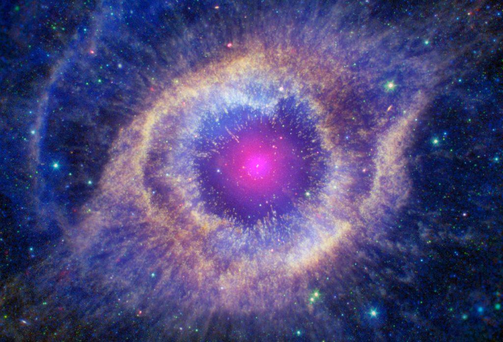 Nebulosa planetária de hélice. Uma estrela anã branca se formou no centro da nebulosa em rosa. Ao redor, alguns cinturões em tons de azul, roxo, amarelo e rosa.