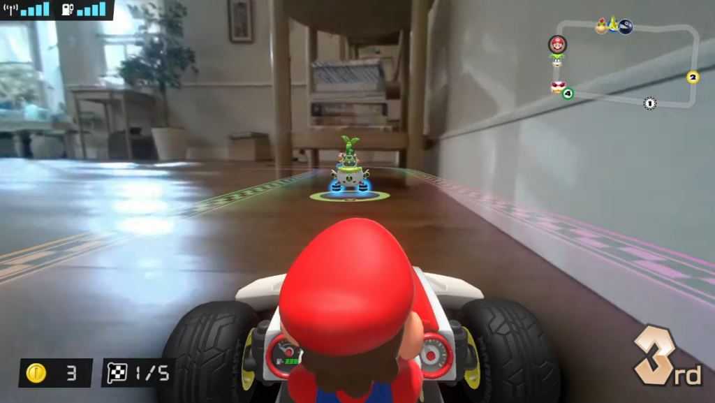 Captura de tela do novo mario kart, onde o jogador assumirá o controle de um carrinho de verdade e a pista será na sua casa