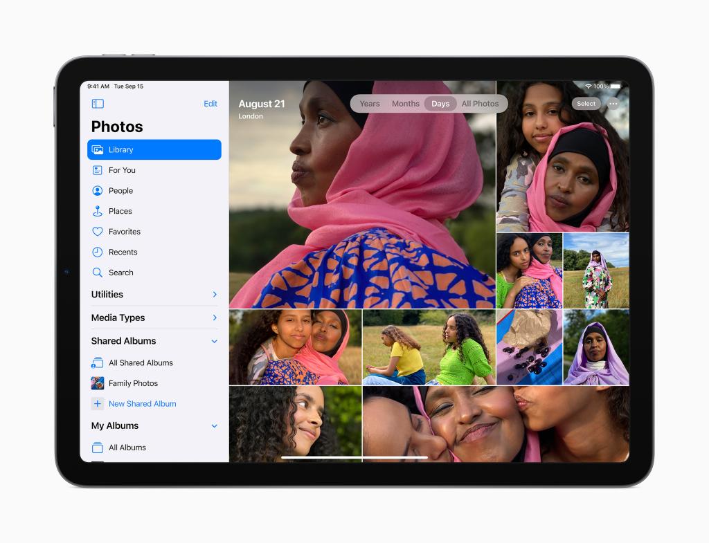 Novo design do aplicativo fotos do ipados 14. O aplicativo agora tem uma barra vertical na lateral esquerda com itens como biblioteca, para você, pessoas e lugares. Os outros dois terços da tela são ocupados por um mosaico de fotos de uma família.