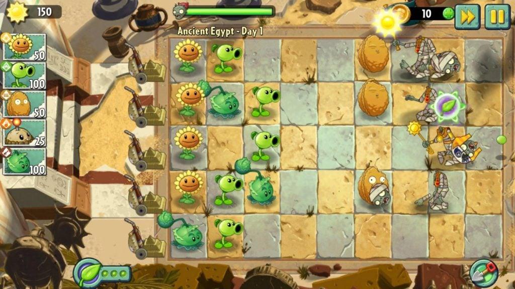 Tela do segundo jogo da franquia; plantas são posicionadas para conter o avanço de zumbis.