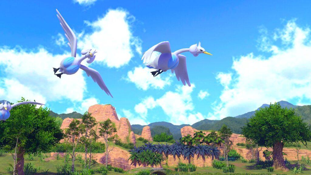 A cena mostra dois pokémon voando em uma floresta com montanhas ao fundo