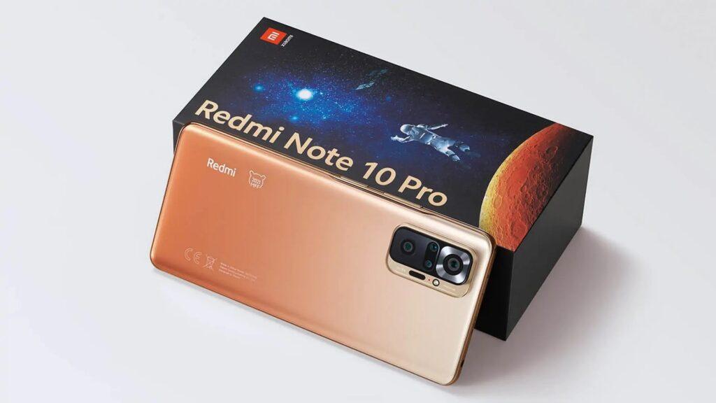 Redmi note 10 pro, de costas, apoiado em sua caixa.