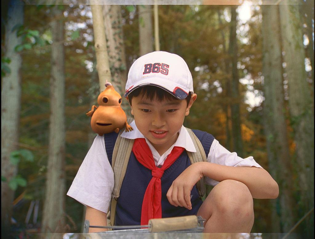 O garoto peisi chen vive o protagonista bao hu lu em a abóbora mágica