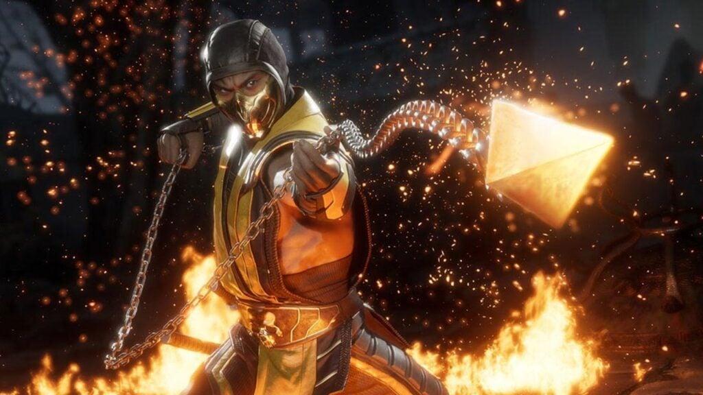 Scorpion, de mortal kombat 11, lança sua corrente em direção à câmera; chamas ao redor do personagem.