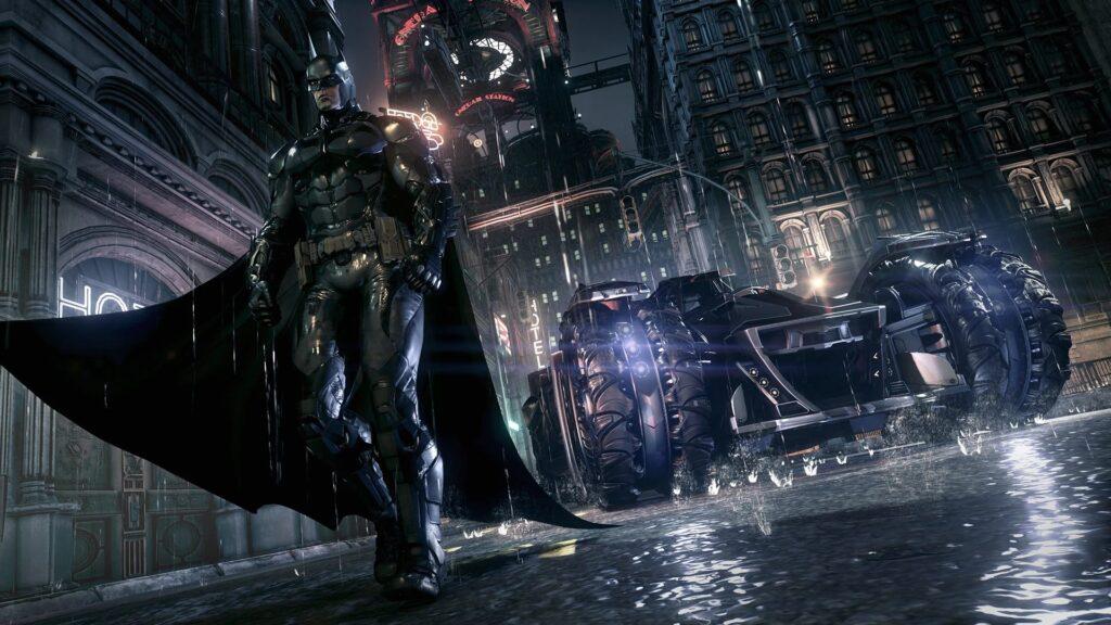 Batman anda à frente de seu batmóvel.