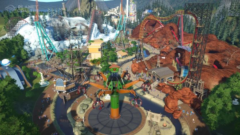 Vista aérea de um parque de diversões com várias atrações.