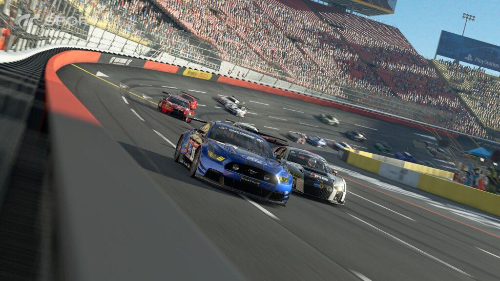 Cena de veículos em alta velocidade em um autódromo.