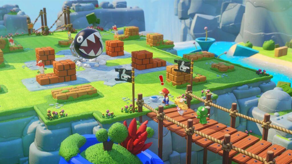 Mario, peach e rabbid luigi chegam a um cenário de batalha, com chain chomp.
